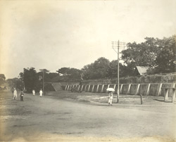 East end of wall used as a water cistern, and also showing one of the square platforms, Madras